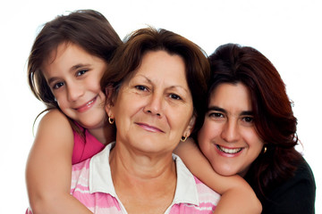 Latin grandmother, daughter and daughter smiling on white