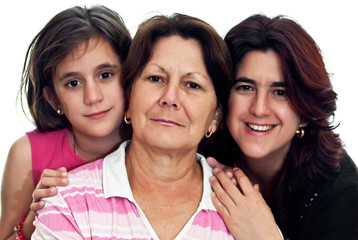 Latin grandmother, mother and daughter isolated on white