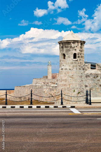 Old colonial castle in Havana with el Morro in the background