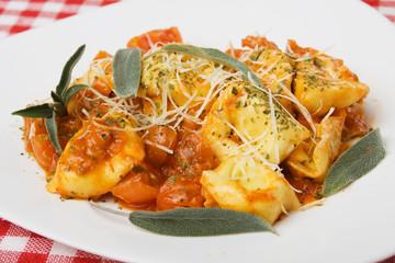 Italian tortellini pasta with tomato sauce