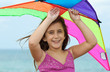 Beautiful latin girl smiling and holding a kite