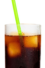 Cola soft drink or Cuba libre with a drinking straw