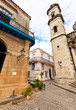 A corner in Old Havana with one of the Cathedral towers and othe
