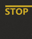 Asphalt texture with a yellow line and the word STOP
