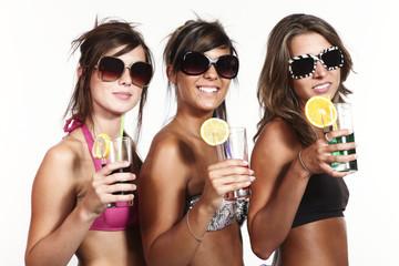 three beautiful and sexy girls in bikini on a white background