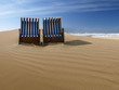 beach chairs on a deserted sand dune