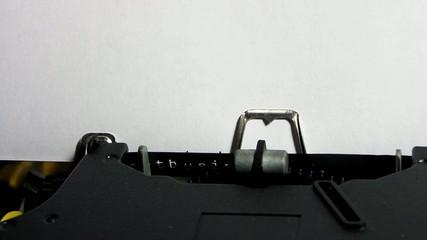 """Typewriter closeup writing """"business"""" on white paper"""
