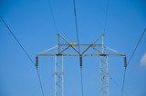 Electricity pylon with blue sky