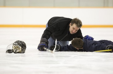 Hockey Player Down On The Ice