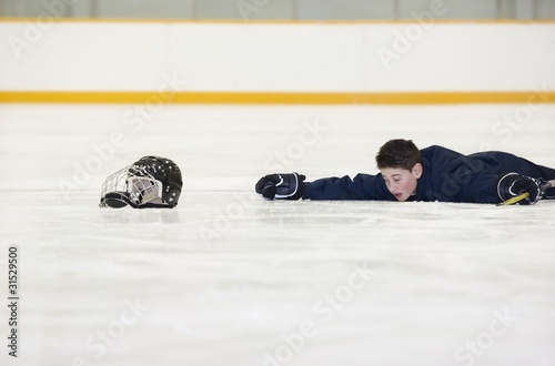 Hockey Player Who Has Fallen On The Ice