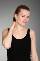 Young woman has neck pain