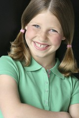 Young Girl With Pigtails In Green Polo Shirt