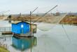 Italy Ravenna canal fishing net
