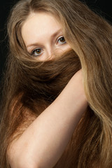 The girl closes long hair the bottom part of the person. A yashm