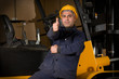 Forklift operator giving okay sign at warehouse.
