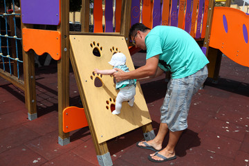 Father with little daughter on the playground