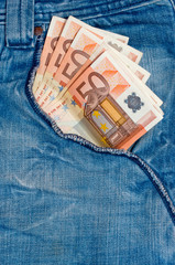 Fifty euro banknotes in the front pocket