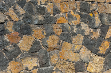traditional wall of volcanic stones at Jeju island Korea
