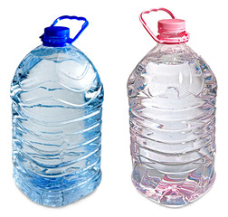 isolated pink and blue full five liter bottles of water