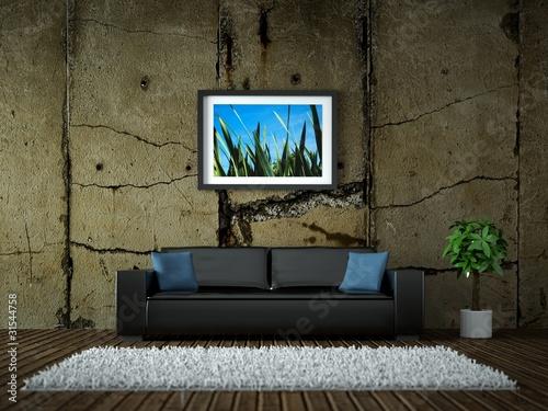 Innendesign - schwarzes Ledersofa vor Betonwand