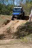 off road vehicle descending a steep hill