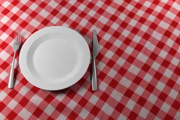 Fork Knife and Plate on a red table cloth