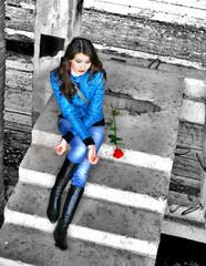 Sad girl sits on steps