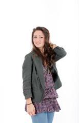 Young brunette teenager girl in studio