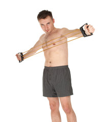 young man doing fitness exercises with expander