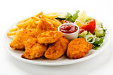 Fototapety Fried chicken nuggets, French fries and vegetables