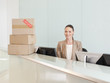 Receptionist with boxes at her desk