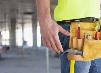 Close up of construction worker?s tool belt on construction site