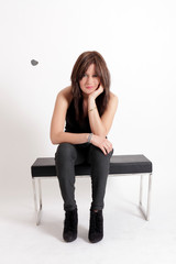 Young brunette teenager girl waiting in studio