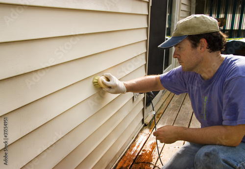 Washing Vinyl Siding of House