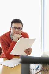 Businessman reviewing report in office