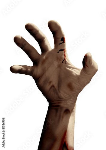 Zombie hand reaching on white background