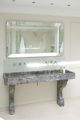 Interior of mirror and trough sink in bathroom
