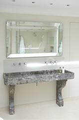 Interior of mirror and trough sink in bathroom