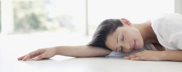 Serene woman napping on floor