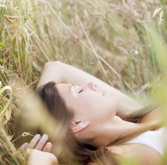 Serene woman sleeping in grass
