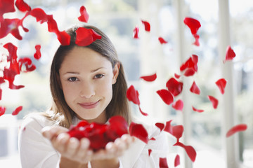Woman holding handful of flower petals
