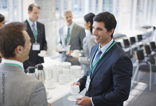 Business people drinking coffee in office