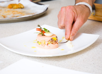 chef decorate plate with food