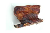 A piece of smoked beef shortrib from a barbeque