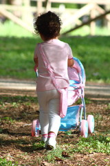 Play with pram in a park