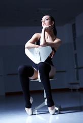 Dancer is relaxing in class room