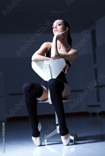 Dancer is relaxing in class room