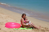 Mother with baby daughter enjoying the beach