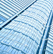 transparent glass wall of contemporary skyscraper