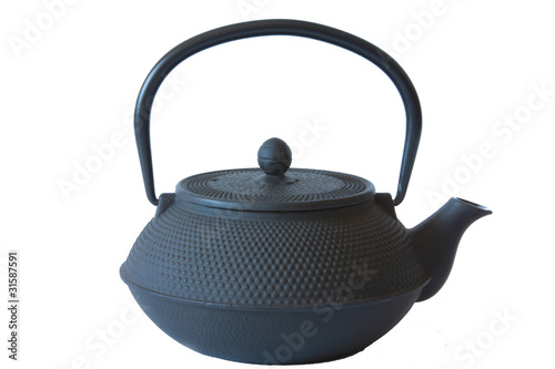 Cast iron kettle for tea on a white background